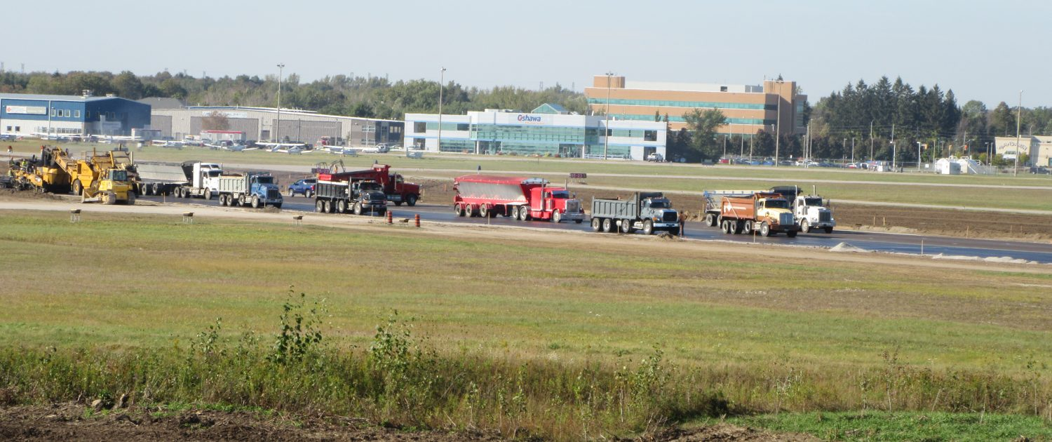 Oshawa Executive Airport job site with lots of trucks